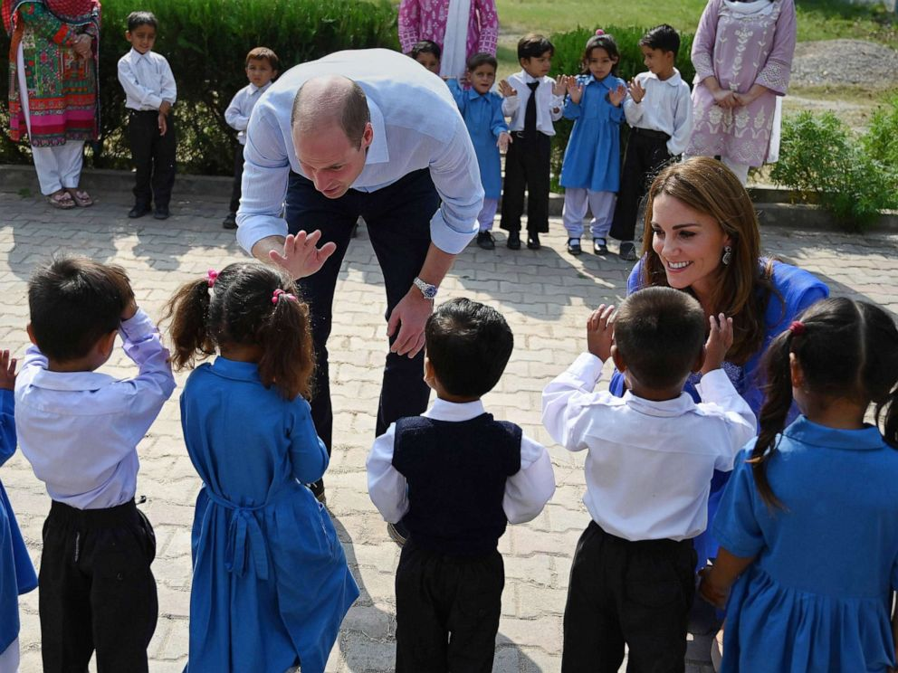 PHOTO: Britains Prince William, Duke of Cambridge, and his wife Catherine, Duchess of Cambridge, meet with school children during their visit to a government-run school in Islamabad, Oct. 15, 2019.