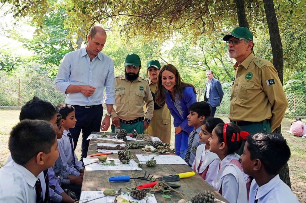 PHOTO: Britains Prince William and Catherine, Duchess of Cambridge talk with local schoolchildren during a visit to the Margalla Hills in Islamabad, Oct. 15, 2019.