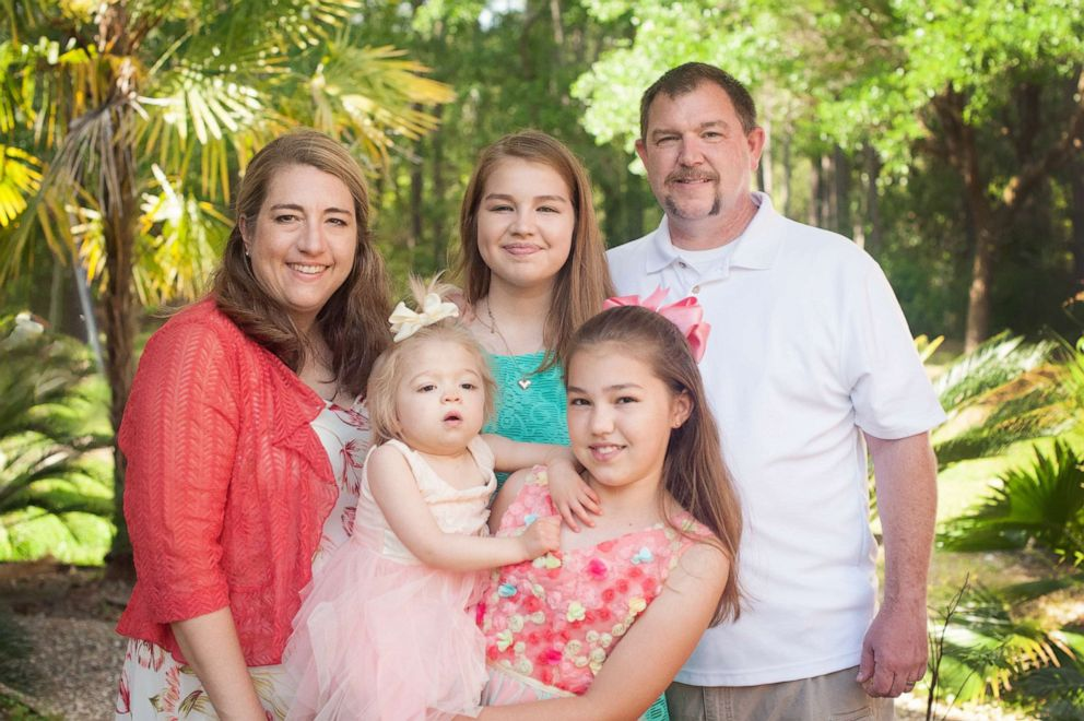 PHOTO: Amber Olsen (left) is pictured with her family. Her daughter, Willow Cannan, has a rare genetic disease, Multiple Sulfatase Deficiency.