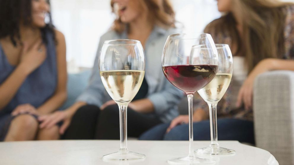 Women are pictured with wine glasses in an undated stock photo.