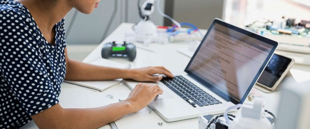 PHOTO: A woman is depicted using a computer in a robotics lab in an undated stock photo.