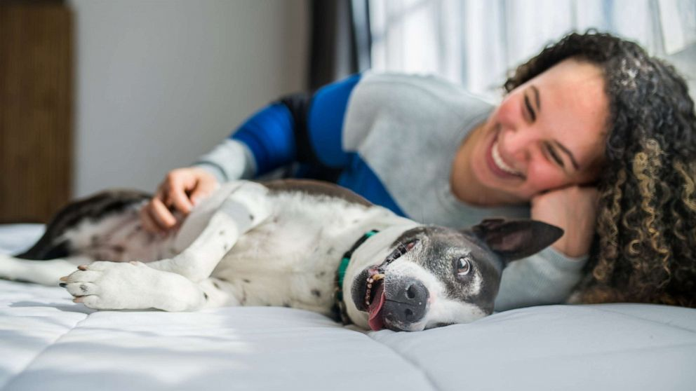 PHOTO: Danielle with her dog Mico, both featured in Kristen Kidd's upcoming third book of the Women's Best Friend project