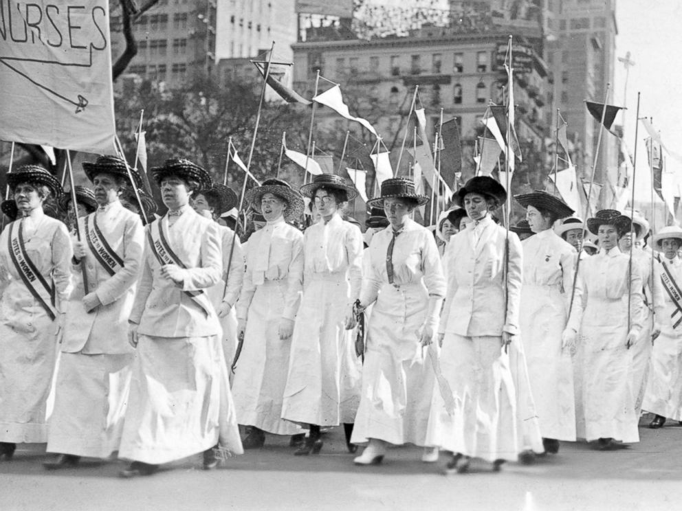 PHOTO: Nurses wearing white Edwardian clothing and sashes reading, Votes for Women, demonstrate in New York in 1913.