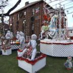 The Mure house in Rockaway Beach, New York is decked out for Christmas with a spectacular Santa's workshop scene.