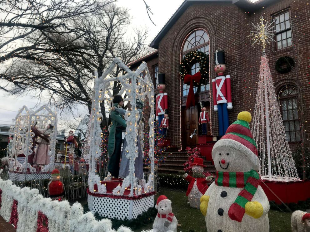 PHOTO: The Mure house in Rockaway Beach, New York is decked out for Christmas with a spectacular Santas workshop scene.