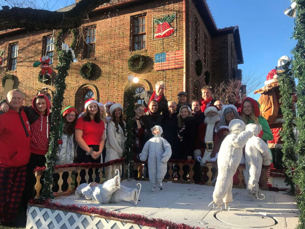 PHOTO: Joe Mure with his family and friends in front of his holiday display at their Rockaway Beach home.