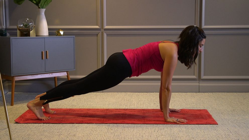 PHOTO: Health and wellness expert Stephanie Mansour shows us how to do cat & cow pose.