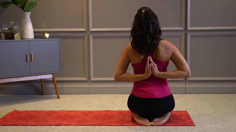 PHOTO: Health and wellness expert Stephanie Mansour shows us how to perform reverse prayer with a neck stretch.