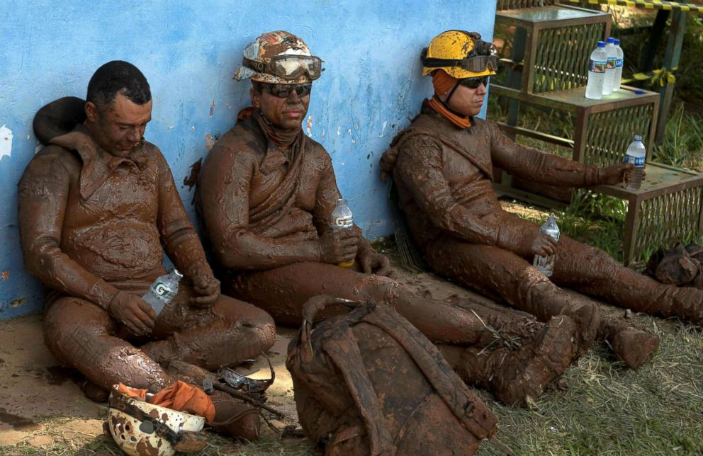 PHOTO: Members of a rescue team react upon returning from the mission, after a tailings dam owned by Brazilian mining company Vale SA collapsed, in Brumadinho, Brazil, Jan. 28, 2019.