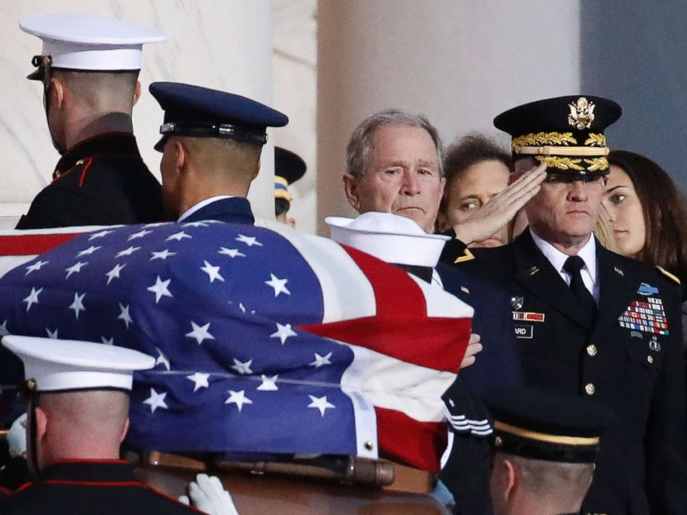 W. Bush watches as the flag-draped casket of his father former President George H.W. Bush is carried by a joint services military honor guard to lie in state in the rotunda of the U.S. Capitol Dec. 3 2018 in Washington