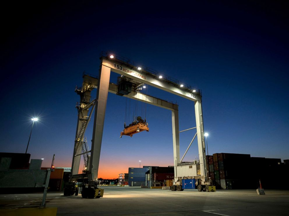 PHOTO: A rubber tire gantry moves into position to transfer shipping containers at the Georgia Ports Authoritys Port of Savannah in Savannah, Ga., Jan. 30, 2018.
