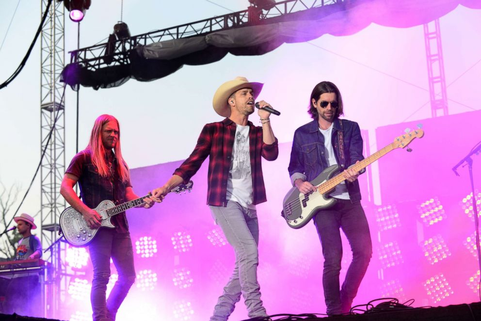 PHOTO: Dustin Lynch, center, performs on stage during the Citadel Country Spirit USA music festival, Aug. 24, 2018, in Glenmoore, Pennsylvania.