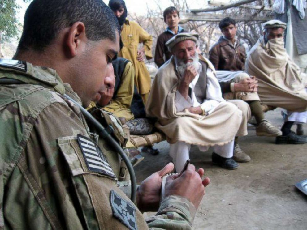 Then-U.S. Army 2nd Lt. Florent Groberg conducts a key leader engagement meeting in Kunar Province, Afghanistan, February 2010.