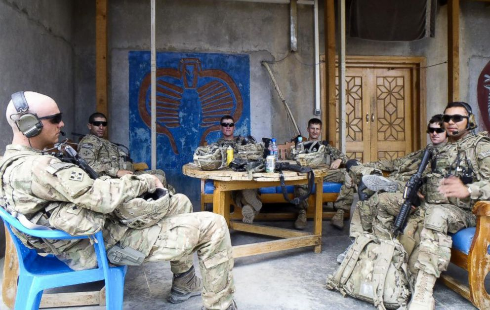 PHOTO: 1st Lt. Florent Groberg, second left, take some downtime during a deployment to Kunar Province, Afghanistan, 2012.