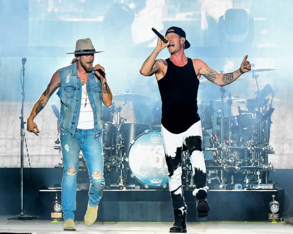 PHOTO: Brian Kelley and Tyler Hubbard of Florida Georgia Line perform at Michigan International Speedway, July 22, 2018, in Brooklyn, Michigan.