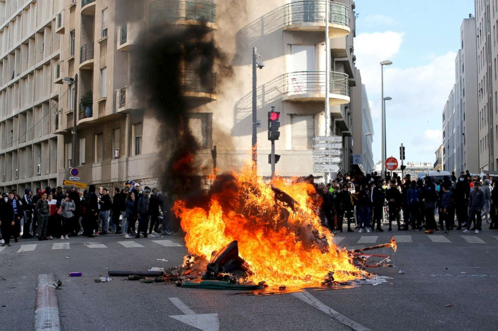 PHOTO: Trash bins burn as youths and high-school students attend a demonstration against the French governments reform plan in Marseille, France, Dec. 6, 2018.