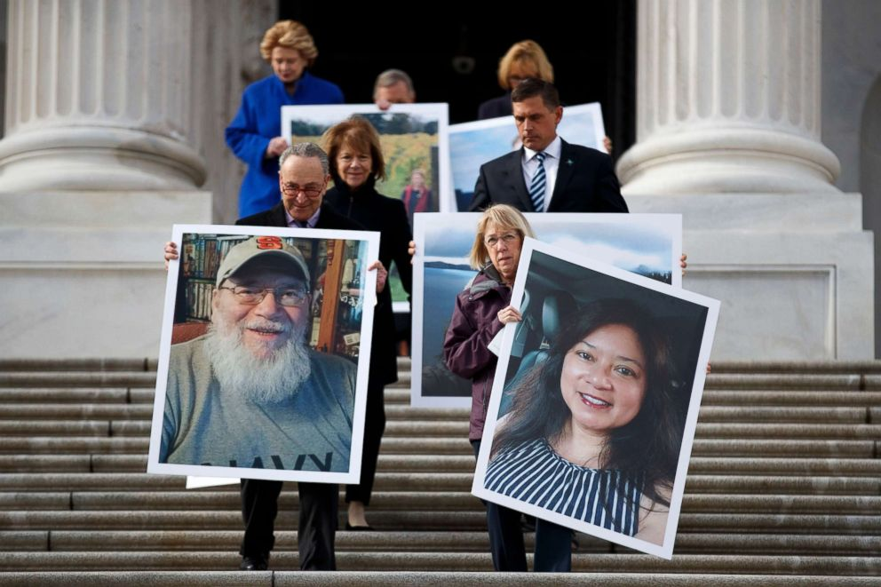PHOTO: Senate Minority Leader Chuck Schumer, Senate Assistant Democratic Leader Patty Murray and Senate democrats carry photographs of furloughed federal workers during a press conference outside the US Capitol, Jan. 16, 2019.