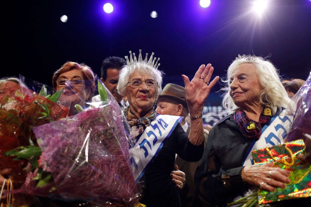 Holocaust survivor Tova Ringer, 93, reacts after winning the annual Holocaust Survivor Beauty Pageant, Oct. 14, 2018, in Haifa, Israel. The pageant was started in 2012 for women who survived the Holocaust.