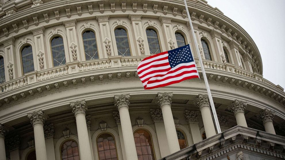 PHOTO: The American flag flies at half staff at the U.S. Capitol Building on the fifth day of the impeachment trial of former U.S. President Donald Trump, on charges of inciting the deadly attack on the U.S. Capitol, in Washington, , Feb. 13, 2021.