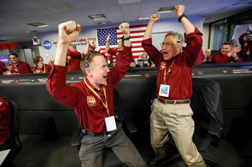 PHOTO: NASA engineers Kris Bruvold, left, and Sandy Krasner react in the space flight operation facility at NASAs Jet Propulsion Laboratory (JPL) as the spaceship InSight lands on the surface of Mars after a six-month journey, Nov. 26, 2018.