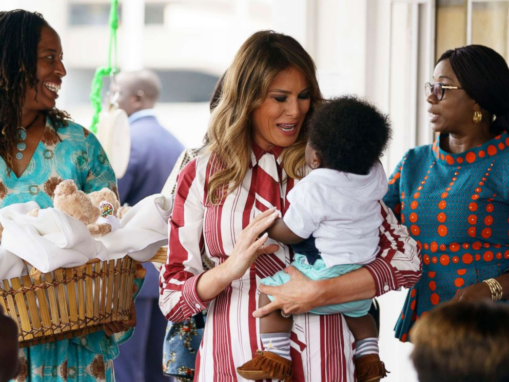 PHOTO: First lady Melania Trump holds a baby as she visits Greater Accra Regional Hospital in Accra, Ghana, Oct. 2, 2018.