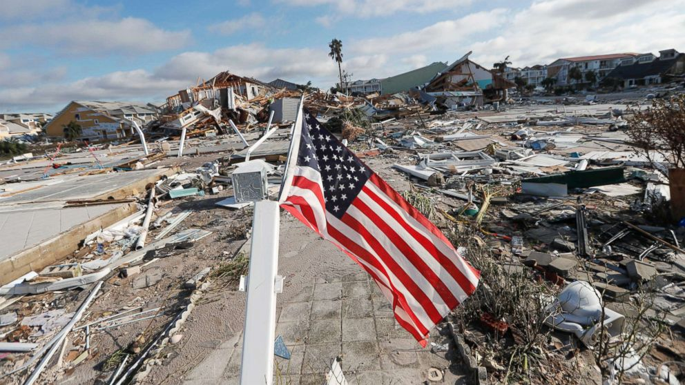 An American flag flies amidst destruction in the aftermath of Hurricane Michael in Mexico Beach, Fla., Oct. 11, 2018.