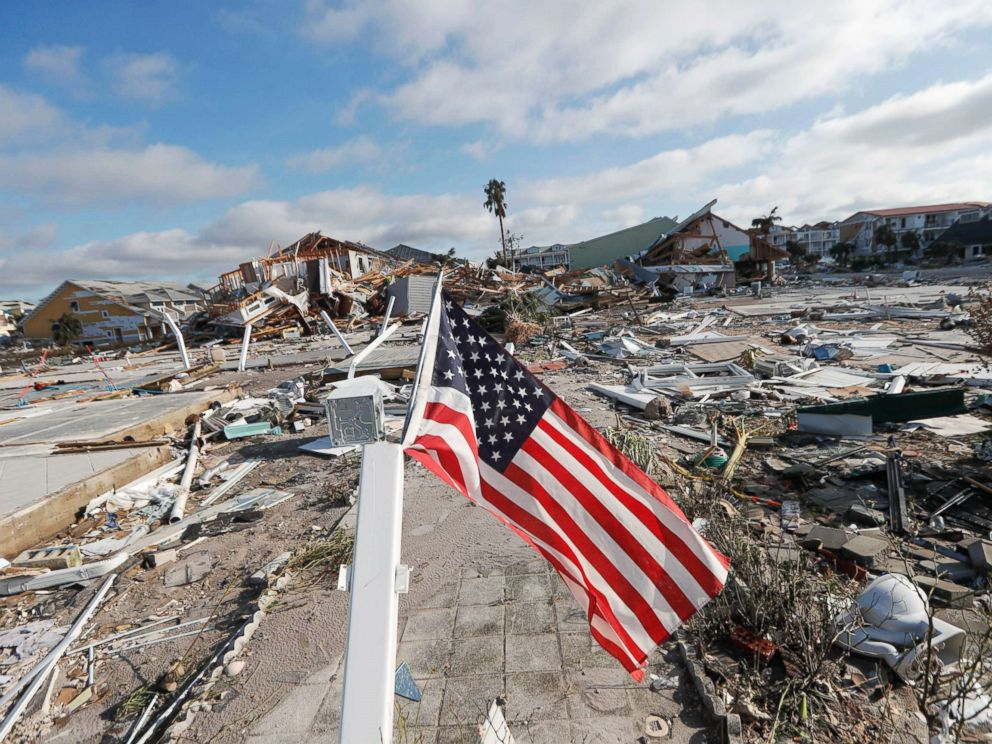 PHOTO: An American flag flies amidst destruction in the aftermath of Hurricane Michael in Mexico Beach, Fla., Oct. 11, 2018.