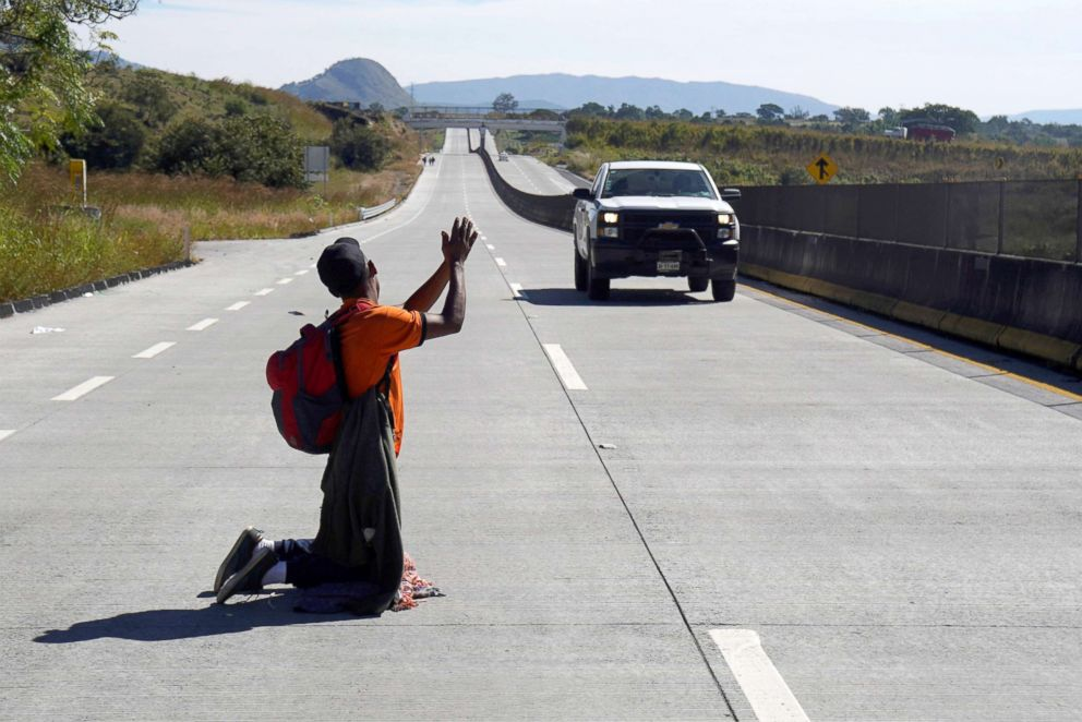 PHOTO: A migrant, part of a caravan of thousands traveling from Central America en route to the United States, attempts to hitchhike on the motorway on the outskirts of Guadalajara, Mexico, Nov. 13, 2018.