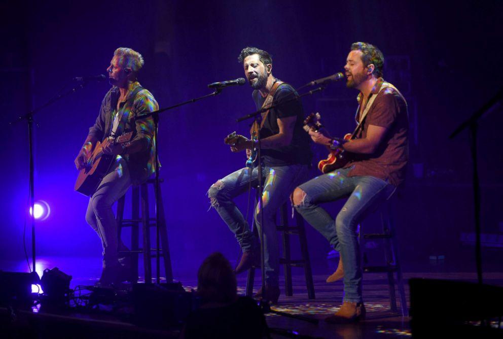 PHOTO: Trevor Rosen, Matthew Ramsey and Brad Tursi of Old Dominion perform at the Ryman Auditorium, Sept. 18, 2018, in Nashville.