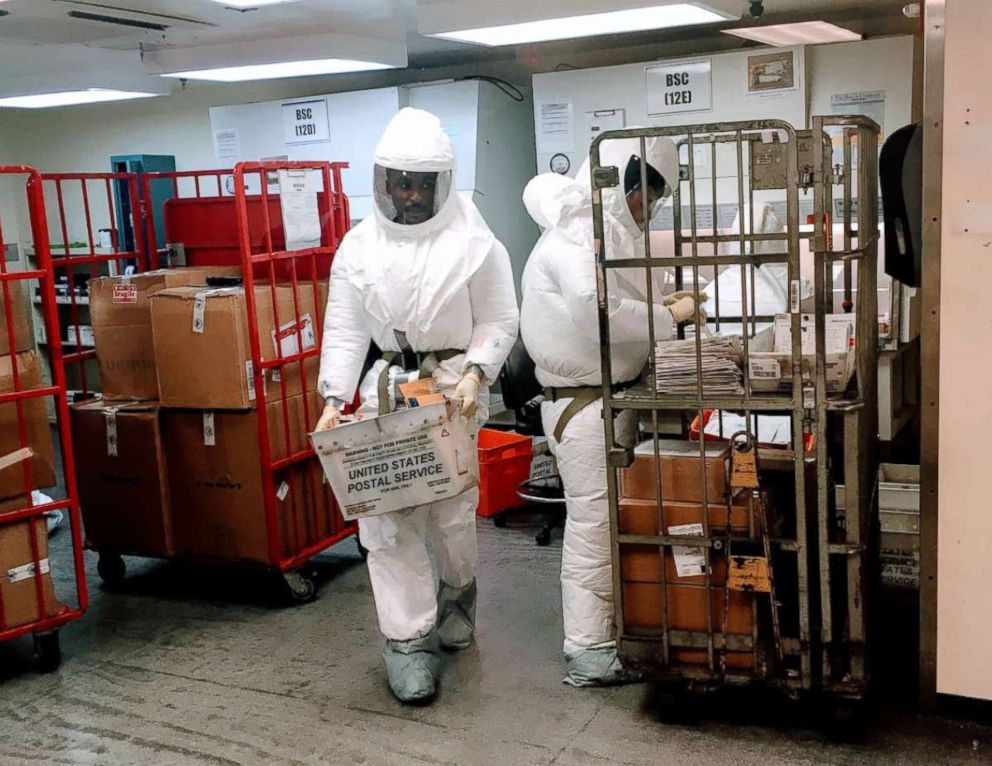 PHOTO: US Defense Department personnel, wearing protective suits, screen mail as it arrives at the Pentagon in Washington, Oct. 2, 2018.