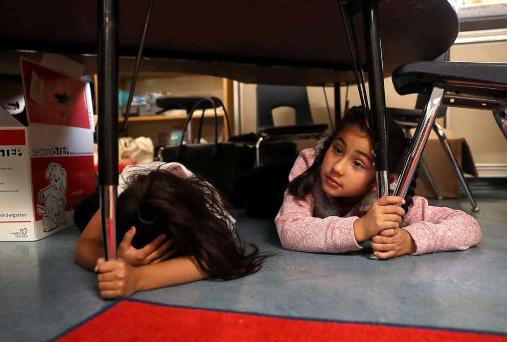 PHOTO: Students at Bryant Elementary School take cover under their desks during an earthquake drill as part of the Great ShakeOut event, Oct. 18, 2018, in San Francisco.