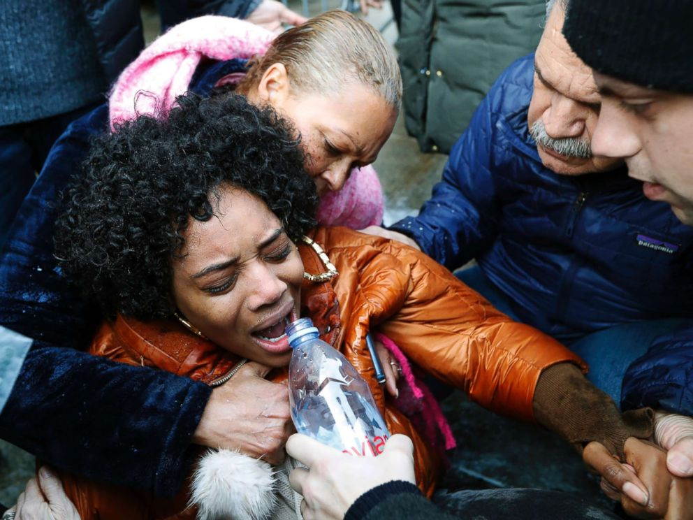 PHOTO: A woman is helped after she was sprayed with pepper spray after she and others stormed the Metropolitan Detention Center, a prison where prisoners have gone without heat, hot water and flushing toilets due to an electrical outage, Feb. 3, 2019.