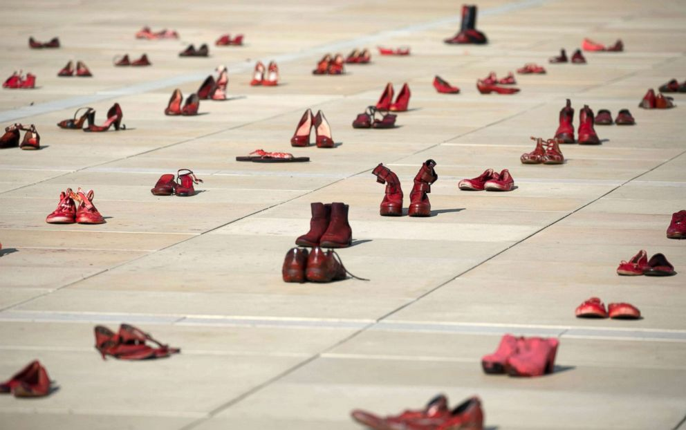 PHOTO: Pairs of red shoes are on display in a central square in Tel Aviv as part of the protest calling for an end to violence against women, Dec. 4, 2018.