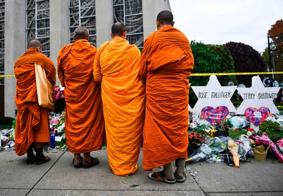 PHOTO: Buddhists pay their respects at a memorial outside the Tree of Life synagogue after a shooting there left 11 people dead in the Squirrel Hill neighborhood of Pittsburgh, Pennsylvania, Oct. 29, 2018.
