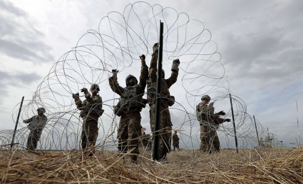 PHOTO: Members of a U.S Army engineering brigade place Concertina wire around an encampment for troops, Department of Defense and U.S. Customs and Border Protection near the U.S.-Mexico International bridge, Nov. 4, 2018, in Donna, Texas.