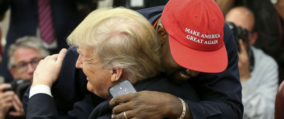 PHOTO: President Donald Trump hugs rapper Kanye West during a meeting in the Oval office of the White House, Oct. 11, 2018.