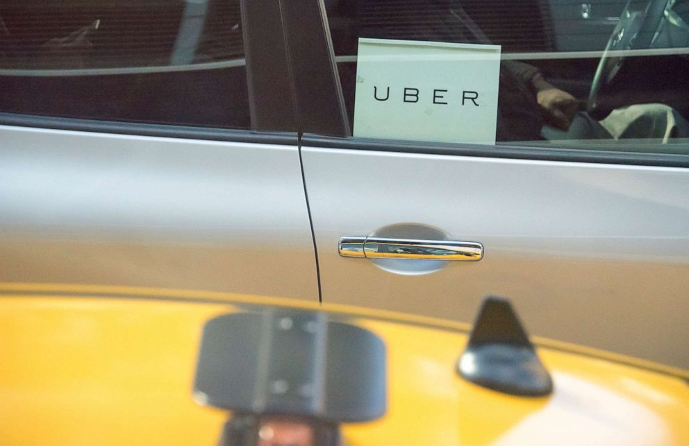 PHOTO: An UBER logo is seen in a car window.