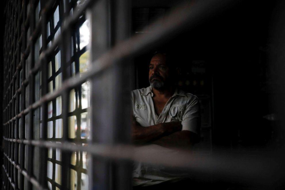 PHOTO: A man stands inside a restaurant during a blackout in Caracas, Venezuela, March 7, 2019.