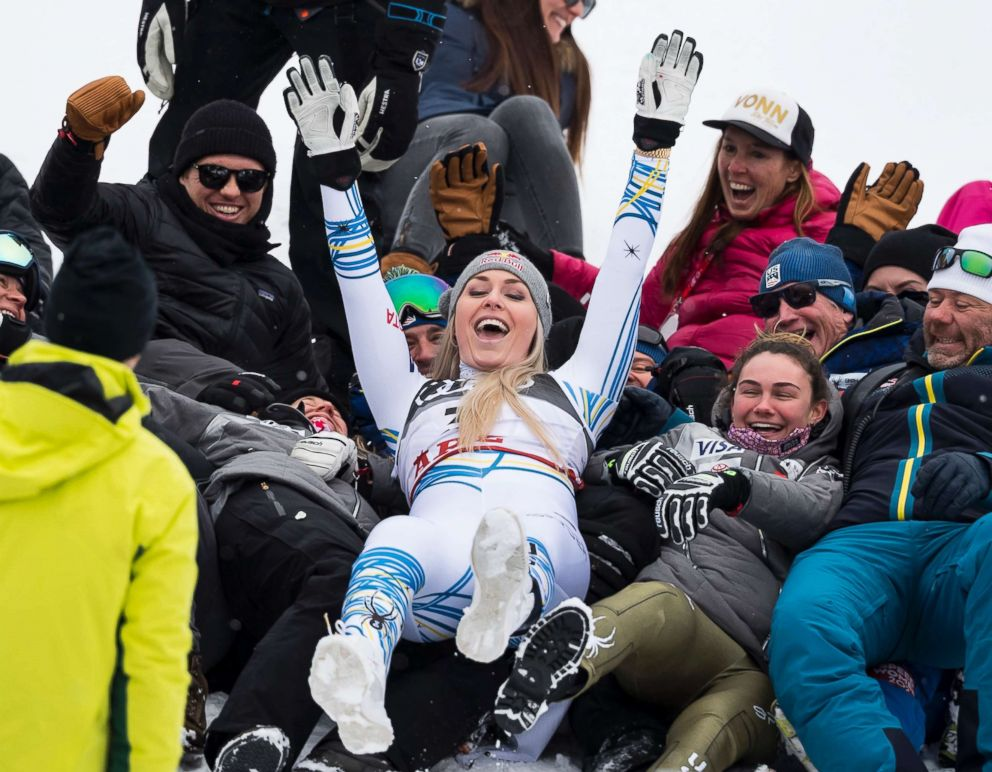 Lindsey Vonn of the United States celebrates with the US Ski members after the flowers ceremony of the women downhill race at the 2019 FIS Alpine Skiing World Championships in Are, Sweden, Feb. 10, 2019.