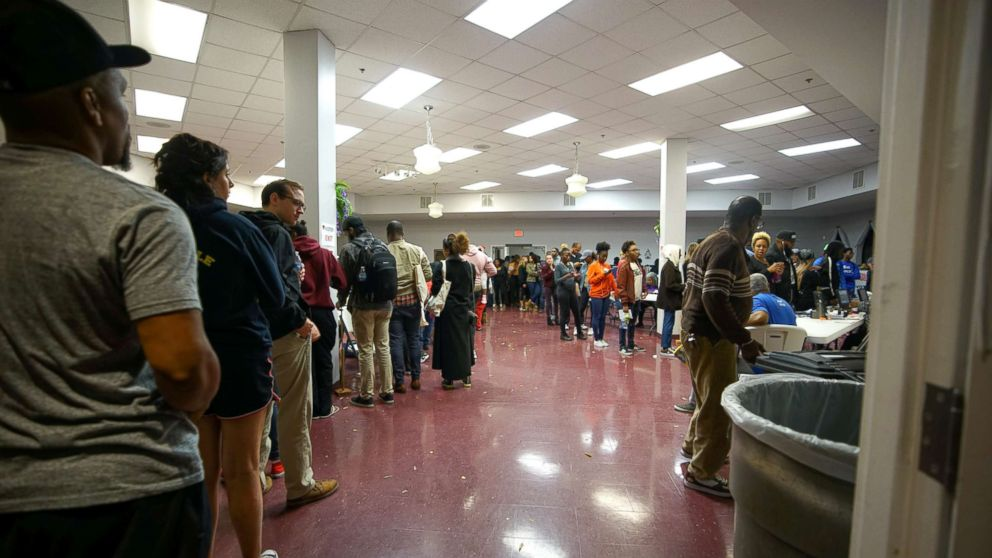 A long line remains past the 7 pm cut off for midterm elections at Liberty Baptist Church in Atlanta, Nov. 6, 2018.