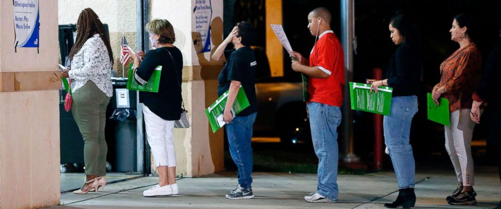 PHOTO: People wait in line to vote at a polling station in Miami, late Nov. 6, 2018.
