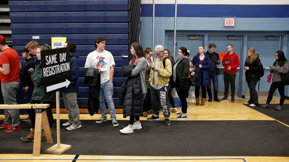 New voters, including many University of New Hampshire students, stand in line to fill out voter registration forms in Durham, New Hampshire, Nov. 6, 2018.
