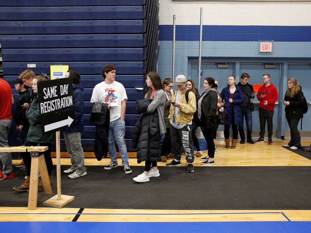 PHOTO: New voters, including many University of New Hampshire students, stand in line to fill out voter registration forms in Durham, New Hampshire, Nov. 6, 2018.