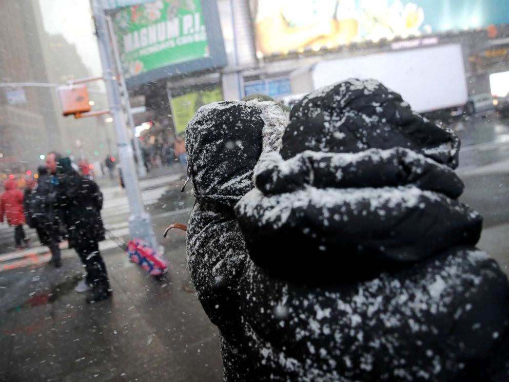 PHOTO: People walk through a snowstorm in Times Square in New York City, Nov. 15, 2018.