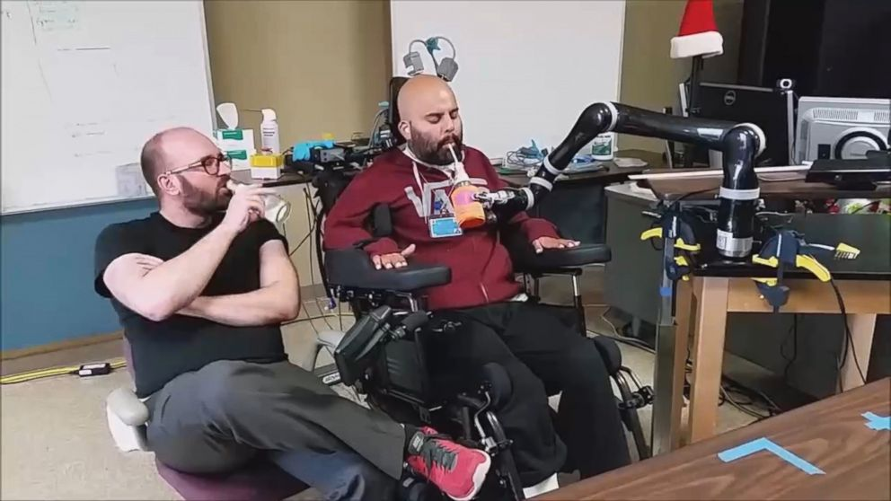Man Paralyzed From Neck Down Drinks Beer With Robotic Arm