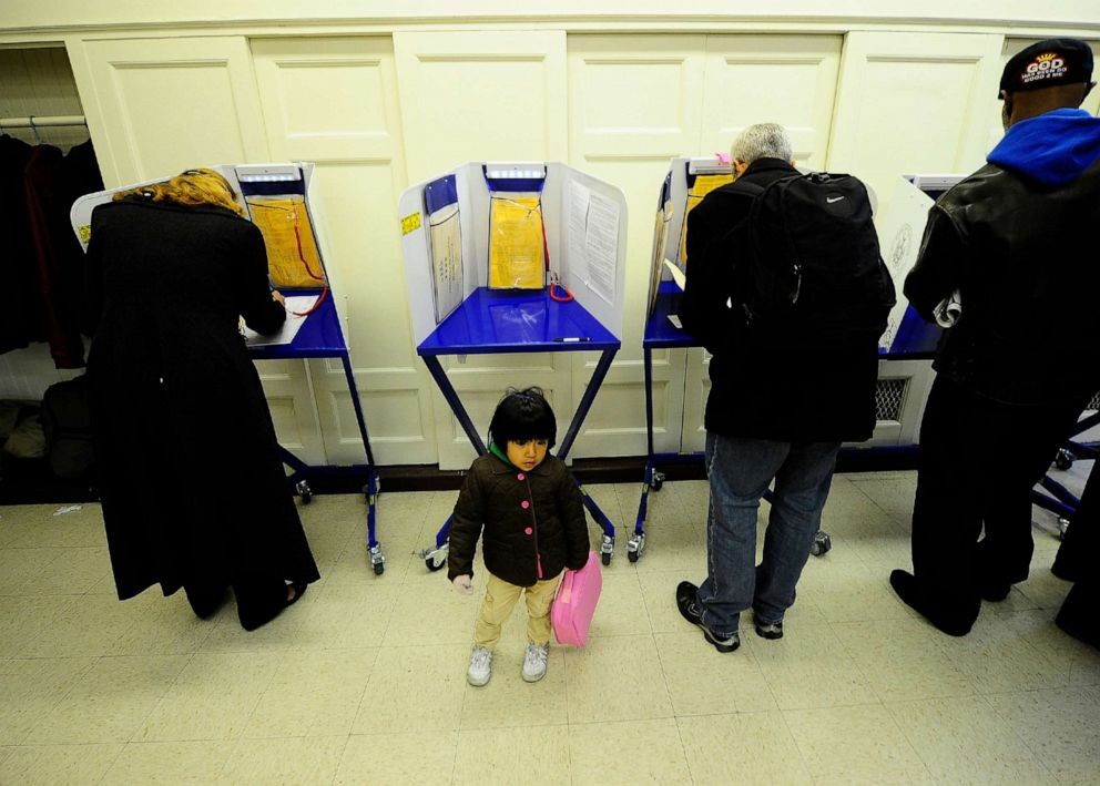 PHOTO: New York residents cast their vote in the mid-term elections at a polling station at a school in New York, Nov. 2, 2010.