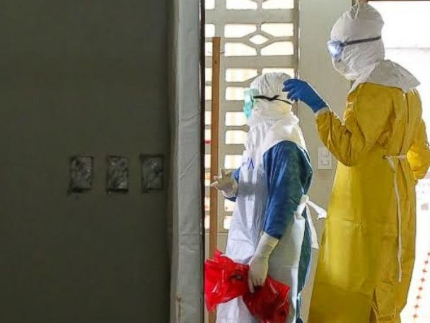 PHOTO: Dr. Besser stands with another doctor at the ELWA Ebola Isolation Unit in Monrovia, Liberia.
