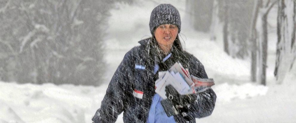 PHOTO: Postal carrier, Charlotte Harding, makes her way along Avenue C West in Bismarck, North Dakota, Nov. 29, 2016, during the second day of a winter storm in central North Dakota.