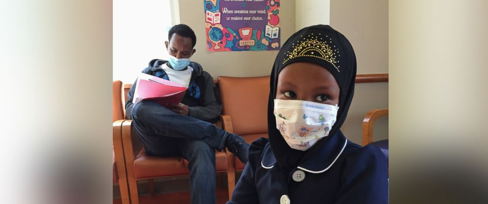 PHOTO: In this Tuesday, May 2, 2017, photo, Amira Hassan,of Burnsville, Minn.,and her father both had to wear a mask to protect them from measles after an outbreak has sickened more than 30 children in Minnesota.