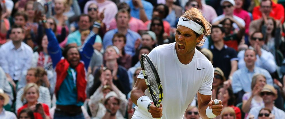 PHOTO: Rafael Nadal of Spain celebrates winning a point against Nick Kyrgios of Australia during their mens singles match at the All England Lawn Tennis Championships in Wimbledon, London, July 1, 2014.